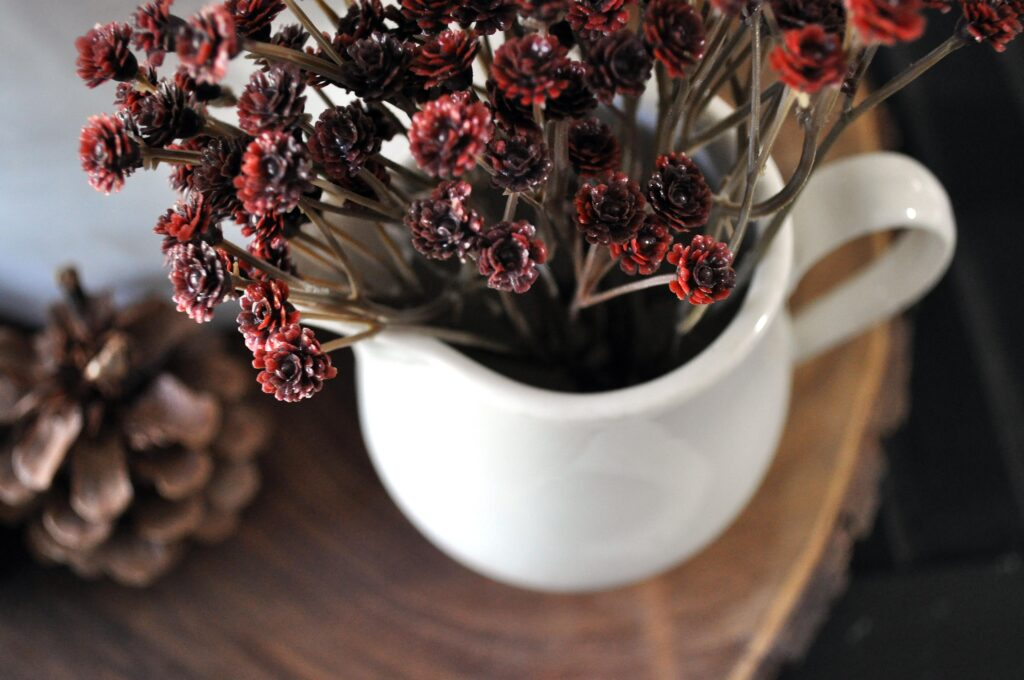 Farmhouse Fall Tour of Homes. Red flowers in pitcher.
